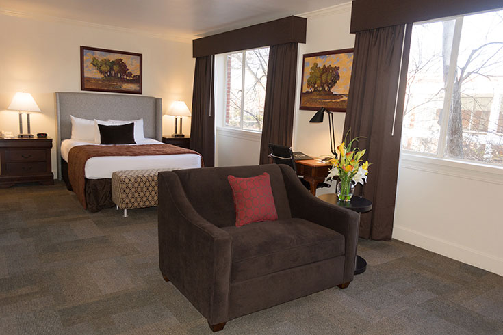 UGA Hotel's Regency Queen is spacious with a separate sitting area