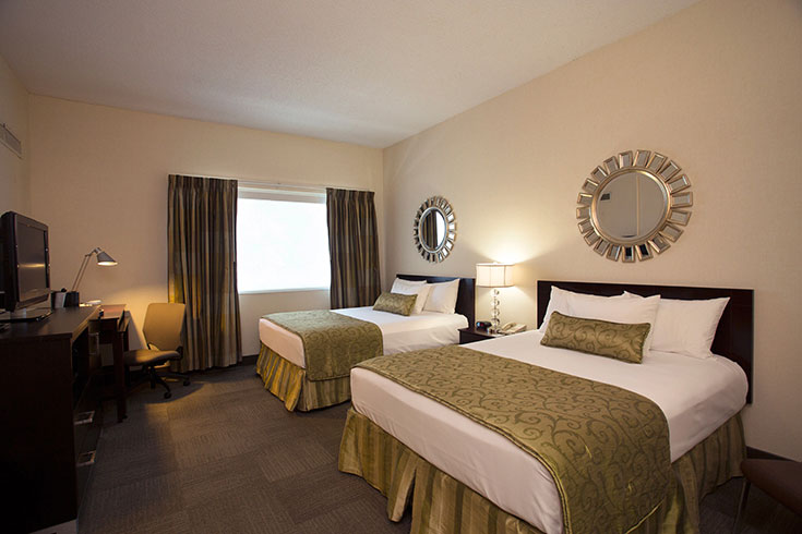 UGA Hotel offers queen rooms that can accommodate up to four guests